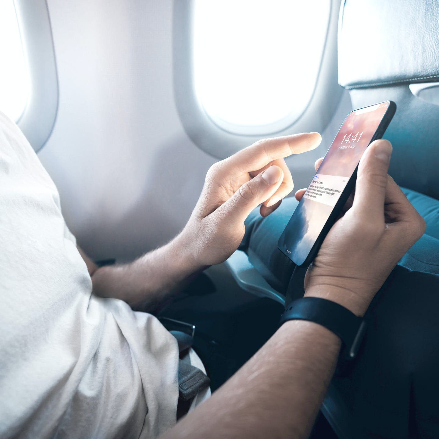 Man using a native mobile app during a flight powered by a full digital platform